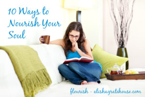 Young woman reading book drinking tea on comfortable couch at home